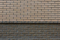 Wall composed of two types of brick yellow and Brown. Background Royalty Free Stock Photos