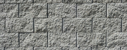 Wall from concrete blocks. Beautiful wide-angle texture from concrete blocks royalty free stock photography