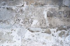 Wall of concrete blocks with a damaged surface. stock image