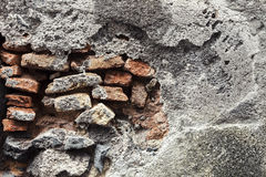 Wall in concrete and bricks. Building background Stock Photos