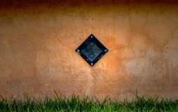 Wall concrete with  lamp and grass.  Royalty Free Stock Photo