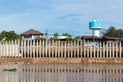 Wall of concrete pillars blocking the river. Many concrete pillars are installed as walls to protect the river from eroded coastal waters near homes Royalty Free Stock Images