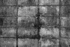 The wall of concrete tiles decorative bricks. textural composition Royalty Free Stock Images