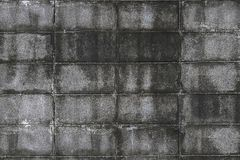 The wall of concrete tiles decorative bricks. textural composition Royalty Free Stock Photography