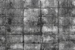 The wall of concrete tiles decorative bricks. textural composition,. Pattern can use for wallpaper or skin wall tile decoration background Stock Photos