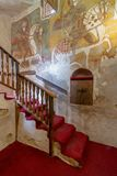 Wall with Coptic fresco paintings and staircase leading to the Church of St. Paul & St. Mercurius, Egypt. Wall with Coptic fresco paintings and staircase leading Royalty Free Stock Image