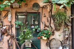 Wall of a countryhouse full of tools and instrument for gardenin Royalty Free Stock Photo