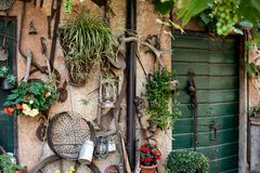 Wall of a countryhouse full of tools and instrument for gardenin Stock Images
