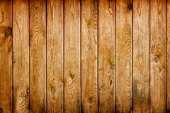 Wall covered with brown grunge wooden boards - natural backgroun Royalty Free Stock Image