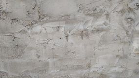 Wall covered with coarse cement gray plaster. Background. Close-up stock images