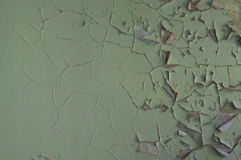 Wall covered with cracked paint Royalty Free Stock Photo