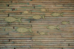 The wall covered with fish wooden art work. The wall covered with fish wooden - background horizontal stock photos
