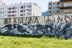 Wall covered with graffitis. Barcelona, Spain - April 9, 2015: Wall covered with graffiti of dogs running in Barcelona, Spain on April 9, 2015 Stock Image