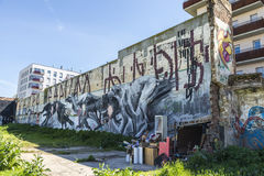 Wall covered with graffitis. Barcelona, Spain - April 9, 2015: Wall covered with graffiti of dogs running beside a barrack in Barcelona, Spain on April 9, 2015 Stock Images
