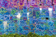 Wall covered with graffitis Stock Photography