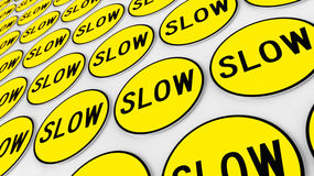Wall Covered in Neat Array of Yellow Slow Signs Stock Photos