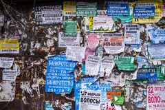 The wall is covered with old ads. VORONEZH, RUSSIA - MAR 29, 2019: The wall is covered with old ads. At the moment city was on the 14th place among the cities royalty free stock photo