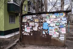 The wall is covered with old ads. VORONEZH, RUSSIA - MAR 29, 2019: The wall is covered with old ads. At the moment city was on the 14th place among the cities royalty free stock photography