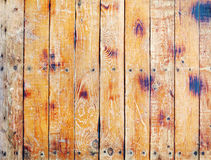 Wall covered with old scratched boards Royalty Free Stock Images