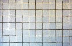 Wall covered with old tile - background royalty free stock images