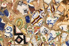 A wall covered with pieces of colorful tiles Stock Photography