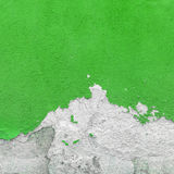 Wall covered with plaster crashed Stock Images