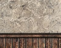 Wall covered with plaster and decorative planks Stock Image