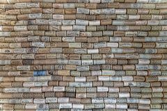 Wall covered in wine corks from various wineries royalty free stock image