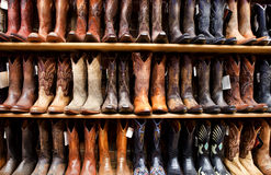 Wall of Cowboy Boots. In a country western store royalty free stock photo