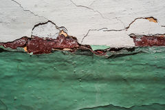 Wall with a crack. In the green plaster Royalty Free Stock Photos