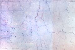 Wall with cracked pale lilac paint. Beautiful background with vignette. Texture of old cover with cracks. Wall with cracked pale lilac paint. Beautiful bright stock images