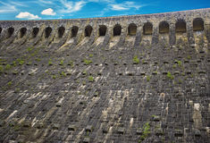 The wall of the dam mountain lake Schwarzenbachtalsperre. Royalty Free Stock Image