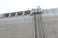 Wall of dam and pushrod for open and close water gateway Royalty Free Stock Photo
