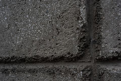 The wall a dark background for grunge. Design Stock Images