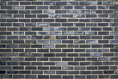 Wall from dark bricks Royalty Free Stock Photo