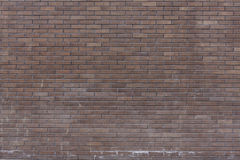 A wall of dark bricks Royalty Free Stock Photos