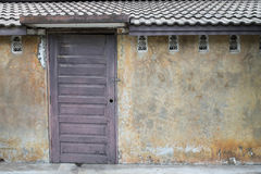 Wall with dark door. Old house white wall with dark door Stock Photos