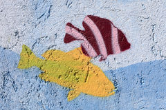 Wall decorated with fish. The blue wall decorated with fish as background royalty free stock photos
