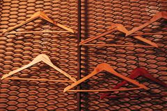 Wall decorated with wooden hangers. Lounge bar interior design. Shoulders for clothes Stock Images