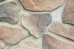 Texture - artificial decorative stone façade. Decorative grey color rough stone wall background texture. Wall of decorative brick. Artificial stone royalty free stock image