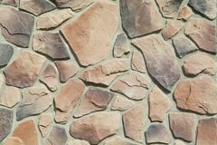 Texture - artificial decorative stone façade. Decorative grey color rough stone wall background texture. Wall of decorative brick. Artificial stone royalty free stock images