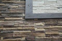 Texture - artificial decorative stone façade. Decorative grey color rough stone wall background texture. Wall of decorative brick. Artificial stone stock photography
