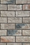 Texture - artificial decorative stone façade. Decorative grey color rough stone wall background texture. Wall of decorative brick. Artificial stone royalty free stock photography