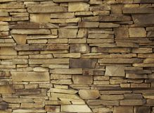 Wall of decorative brick uneven laying of the building facade, o. Utdoor Stock Image
