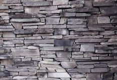 Wall of decorative brick uneven laying of the building facade. Outdoor Stock Photography