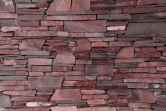 Wall of decorative brick uneven laying of the building facade, o royalty free stock photography