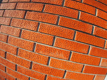 Wall of decorative red bricks close up Royalty Free Stock Images