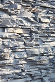 Wall of decorative stone in gray. Shallow depth of field, abstract background. Stock Photo