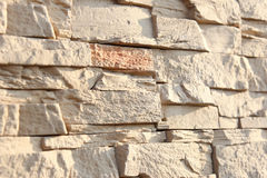 Wall of decorative stone sand color. Shallow depth of field, abstract background. Stock Images