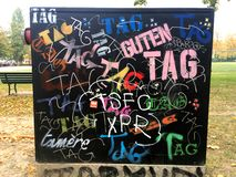 A Wall Designated for Graffiti Tagging. An image of a box in the city which is provided as a legal space for graffiti writers to scrawl their names. It is full stock images